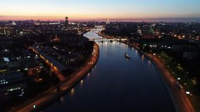 The big city and the river at sunset in the summer stock video