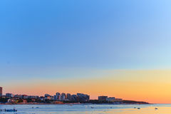 Big City by the sea at sunset Stock Photo