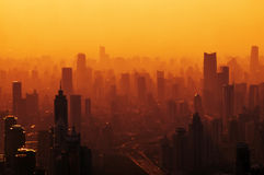 Big city at sunset - panorama. Big city in the fog - a view from the top stock photos