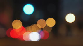Blur Traffic. A busy city street with cars and traffic lights. The camera is out of focus / defocused to give the blurry bokeh effect. Perfect as an abstract stock footage