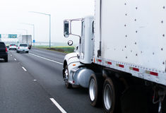 Big classic rig semi truck white trailer highway straight pipes stock image