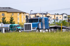Big classic semi truck on the high way exit rump Royalty Free Stock Photo
