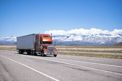 Big classic well maintained semi truck on high way stock photo