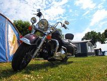 Big classical motorcycle in camping Royalty Free Stock Photo