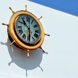 Big Clock. A Big Clock on a white wall displaying the time in roman numerals Stock Photos