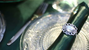 Big close up of luxury wedding table with silver and diamond cutlery