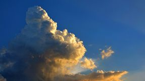 Big cloud and golden light. From sunset in evening time Stock Photo