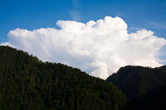 Big cloud over hills Stock Photography