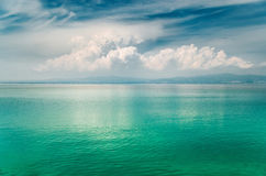 Big cloud over the mirror turquoise Aegean sea, Greece Stock Photo