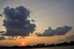 Big Santa Claus-like cloud on sunset stock photo