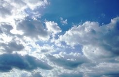 Big cloud spreading on sky in sunny day stock photography