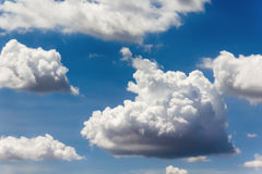 Big clouds in blue sky Stock Images
