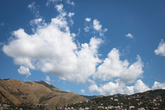 Big clouds on a high grassy hill Royalty Free Stock Images