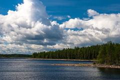 Big clouds over lake Royalty Free Stock Photography