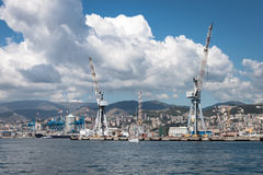 Big clouds over the port of Genoa, Italy Stock Images