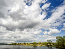 Big clouds. Over the river Royalty Free Stock Image