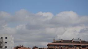 Big Clouds Over The Rooftops stock video footage