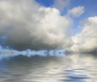 Big clouds reflected. From the water Stock Photos
