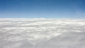 Big Clouds and Sky from Window Plane Stock Image