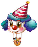 A big clown balloon with a basket full of kids Stock Photography