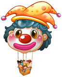 A big clown balloon with kids in the big basket Royalty Free Stock Photo