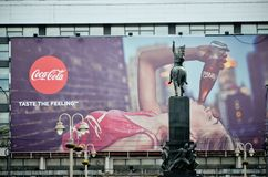 Big Coca Cola advertisement in center of city stock image