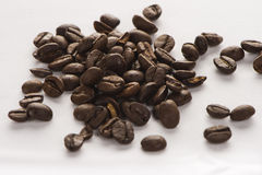 BIG COFFEE BEANS separated. Italian black COFFEE BEANS on the white background Royalty Free Stock Images