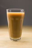 Big Coffee With Milk. Big glass of hot coffee with milk on a wooden table Royalty Free Stock Photography