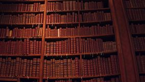 Big collection of old uncognizable books. 4K pan shot