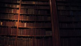 Big collection of old uncognizable books. 4K steadicam shot