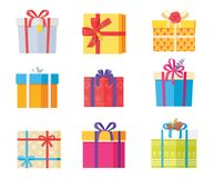 Big Collection Present Gift Boxes Color Wrapping. Big collection of present gift boxes in color wrapping paper, decorated by bows, pine cones, rose flowers Stock Photography