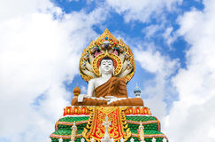 Big colorful buddha statue sitting thai temple Stock Photo