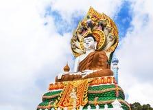 Big colorful buddha statue sitting thai temple Stock Photos