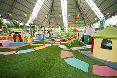 Big colorful children playground. Equipment in middle of park Stock Image