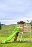 Big colorful children playground equipment. In middle of park Stock Photography