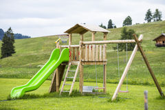 Big colorful children playground equipment. In middle of park Royalty Free Stock Photography