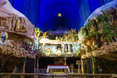 Big and colorful Christmas crib. In a church in Poznan, Poland the biggest crib in Poland taking place every year between December and February royalty free stock photo