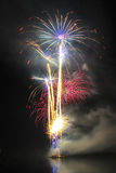 Big colorful fireworks over night the water. Colorful fireworks over night the water Stock Photos