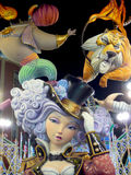 Big colorful giant papier mache figures at night in Fallas festival of Valencia. Sculpture of ninots colorful. Woman in circus Stock Images