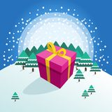 Big colorful packed gift box on winter forest background Stock Photography