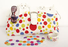 Big colorful polka dots bag with cute matching accessories. Stock Image
