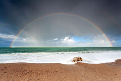 Big colorful rainbow over ocean stock images