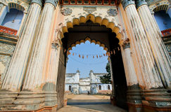 Big columnes of the entrance to historic indian palace Royalty Free Stock Images
