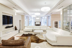 Big and comfortable living room. With white interior in luxury mansion Stock Photography