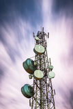 Big communication tower and beautiful longexposure in the night Royalty Free Stock Photos