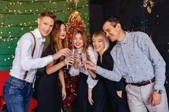Big company celebrates a new year with glasses of champagne royalty free stock photo