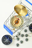 Big compass in cart and ten black compasses Stock Image