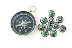 Big compass with ten black small compasses Royalty Free Stock Photography