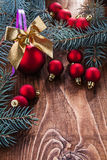 Big composition of christmas toys red baubles gold colored bow a Stock Photo