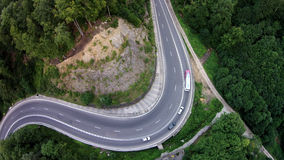 The big concret road snake. Crossing road between mountains, brasov county Romania Stock Photos
